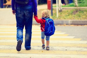 father with little daughter walking to school or daycare